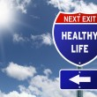 Red and blue interstate road sign Next Exit Healthy life — Stock Photo #48901043