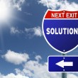 Next exit Solutions red and blue interstate road sign — Stock Photo #48901077
