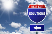Next exit Solutions red and blue interstate road sign — Foto de Stock