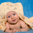 Smiling baby lying on a blue background — Stock Photo #48443473