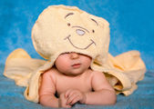 Funny baby lying on a blue background — Stock Photo