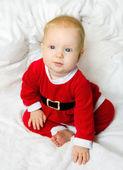 Baby girl dressed as Santa Claus — Stock Photo