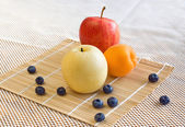 Pear, apple, apricot, blueberries — Stock Photo