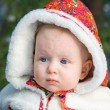Closeup portrait of baby in fur coat — Stock Photo #49350815