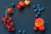 Berries on black blue background — Stockfoto