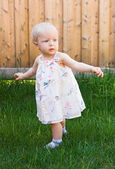 Baby girl trying to walk — Stock Photo