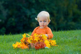 Funny baby with pumpkins halloween — Stock Photo