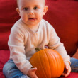 Funny baby with pumpkin — Stock Photo #51439297