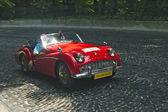 Red Triumph at retro car racing track Leopolis Grand Prix — Foto Stock