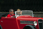 Driver of vintage Rosengart car at Leopolis Grand Prix — Stock Photo