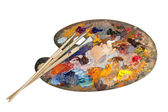 Artist palette with set of brushes — Stock Photo