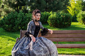 Beautiful woman in vintage dress — Stock Photo