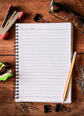 Notepad with a spiral binding on wood table — Stock Photo