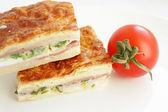 Puff pastry pie with ham and eggs — Stock Photo