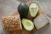 Avocado and a loaf of bread — Stock Photo