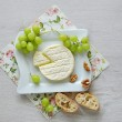 Goat cheese and grapes on the plate — Stock Photo #47894749