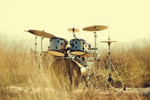Drum set in the field — Stock Photo