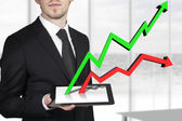 Businessman tablet line graph — Stock Photo