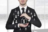 Businessman protecting dollar employees — Stock Photo