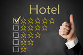 Thumbs up hotel rating stars — Stock Photo