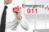 Doctor drawing heartbeatline emergency 911 — Stock Photo