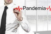 Doctor writing pandemia heartbeatline — Stock Photo