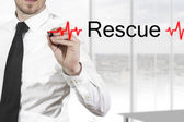 Doctor drawing heartbeatline rescue — Stock Photo