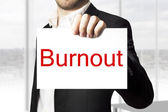 Businessman holding sign burnout — ストック写真