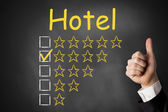 Thumbs up Hotel four star rating — Stock Photo