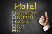 Thumbs up chalkboard hotel rating one star — Stock Photo