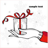 Hand holding Christmas present — Stock Vector