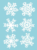 Snowflakes hand paper cut — Stock Vector