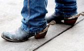 Cowboy boots with spurs rusted silver spurs attached — Stock Photo