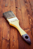 Single brush on brown wood — Foto de Stock