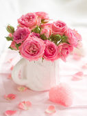 Pink roses with candle — Stock Photo