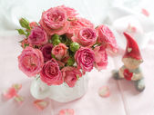 Pink roses and small dwarf — Stock Photo
