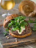 Hamburger with arugula — Stock Photo