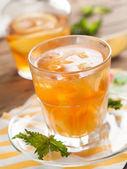 Iced tea with lemon slices — Stock Photo