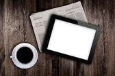 Before work newspaper, coffee and tablet — Stock Photo