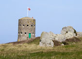Loophole towers in Guernsey that guard the coastline. — Stock Photo