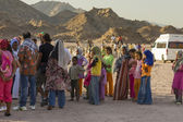 Bedouin People with camels — Stock Photo