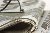 Newspaper with specs — Stockfoto