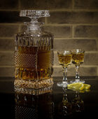 Crystal decanter of whisky and two glasses — Stock Photo