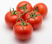 Five tomatoes — Stock Photo