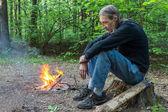 Sad man at a fire — Stock Photo