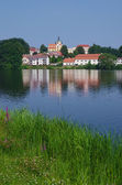 View of church and pond — Stock Photo