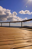 Wooden trail and blue sky — Stock Photo