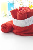 Rolled up red towels — 图库照片