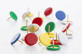 Multicolored thumbtacks — Stock Photo