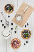 Blueberry and raspberry tartlets — Stock Photo